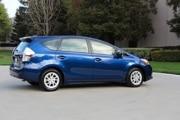 2014 Toyota Prius V hybrid:  $27,560  44/40/42 mpg