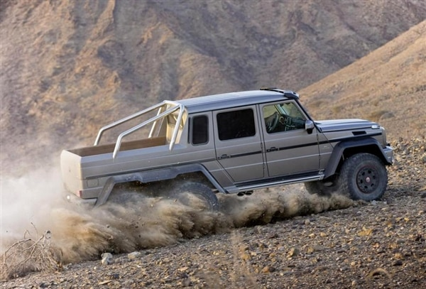 m-b-g63-amg-6x6-gray-action-profile-sand-tossing-600-001