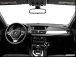 2014 BMW X1 Dashboard, center console, gear shifter view photo